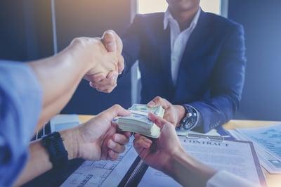 ART_Businessman signs contract, handshake and exchange money