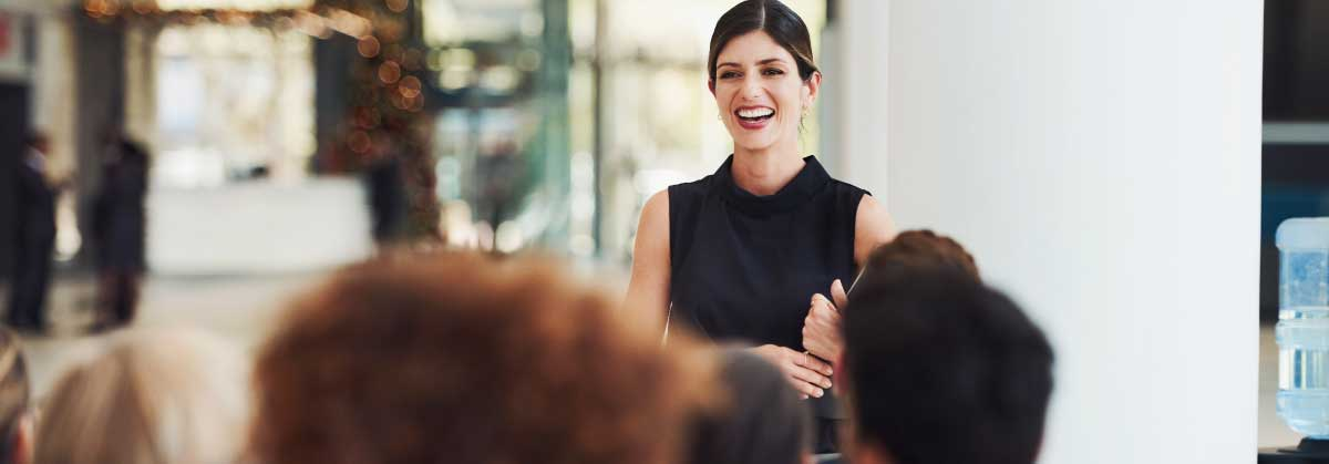 woman_smiling_giving_presentation